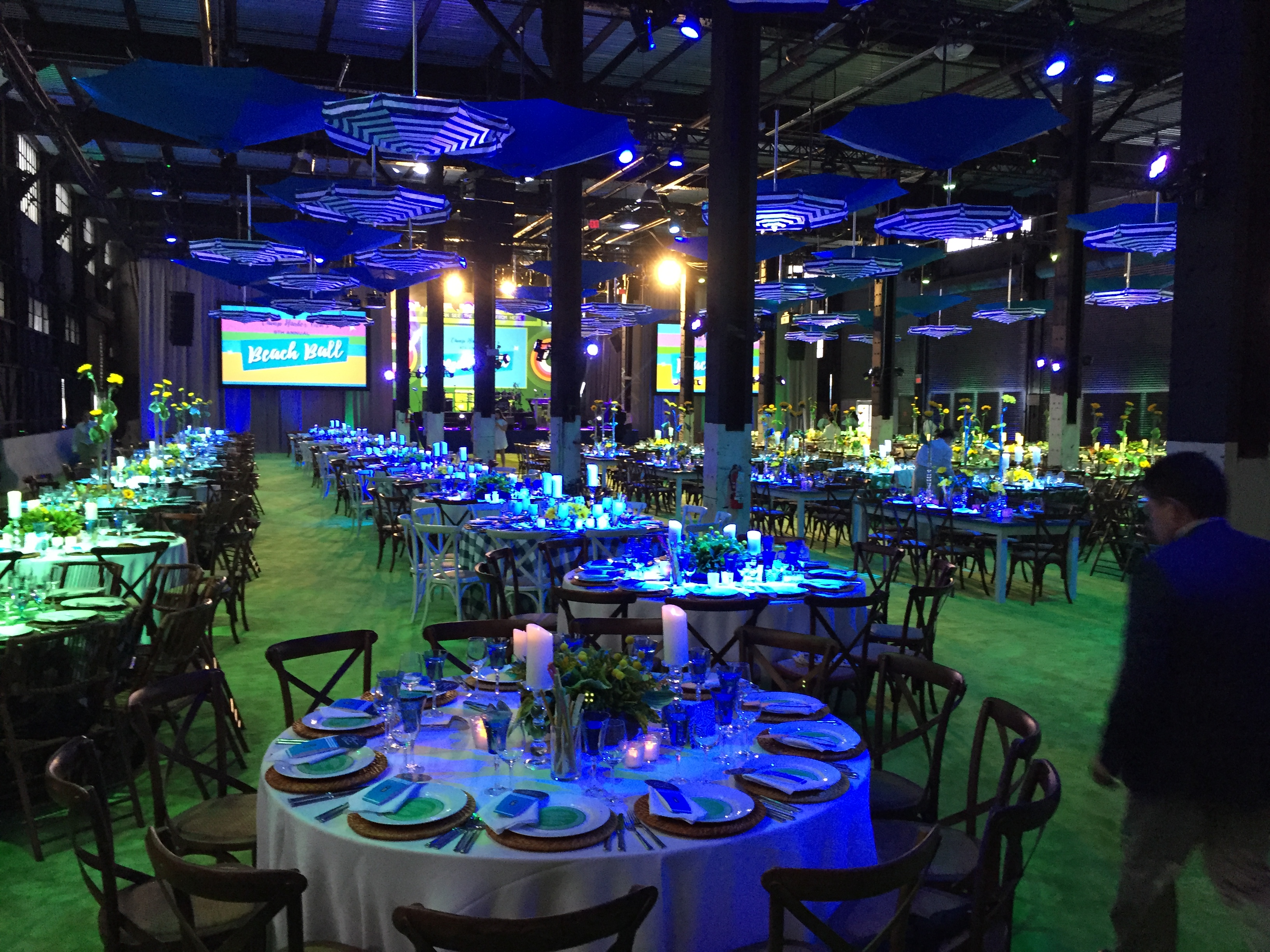 The Warehouse set up for a reception, with round tables.