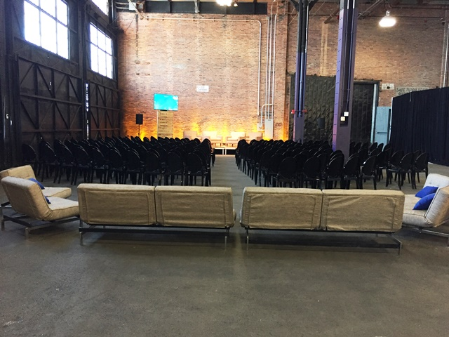 The Warehouse set up for a ceremony, with several rows of chairs.