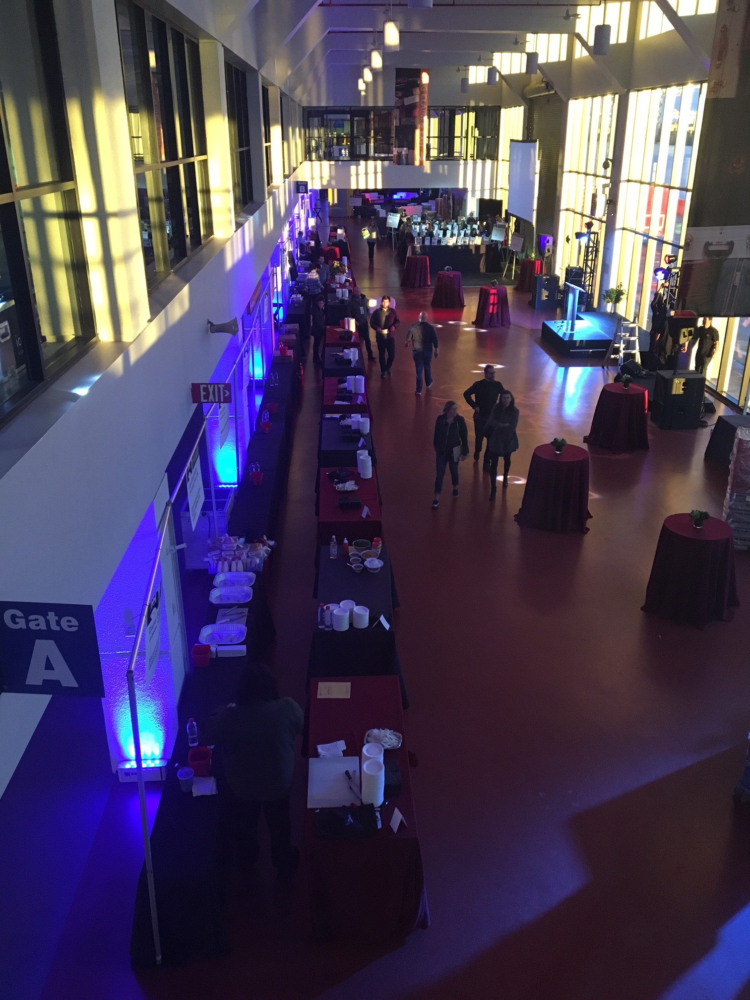 View of the first floor set up with booths and high top tables.