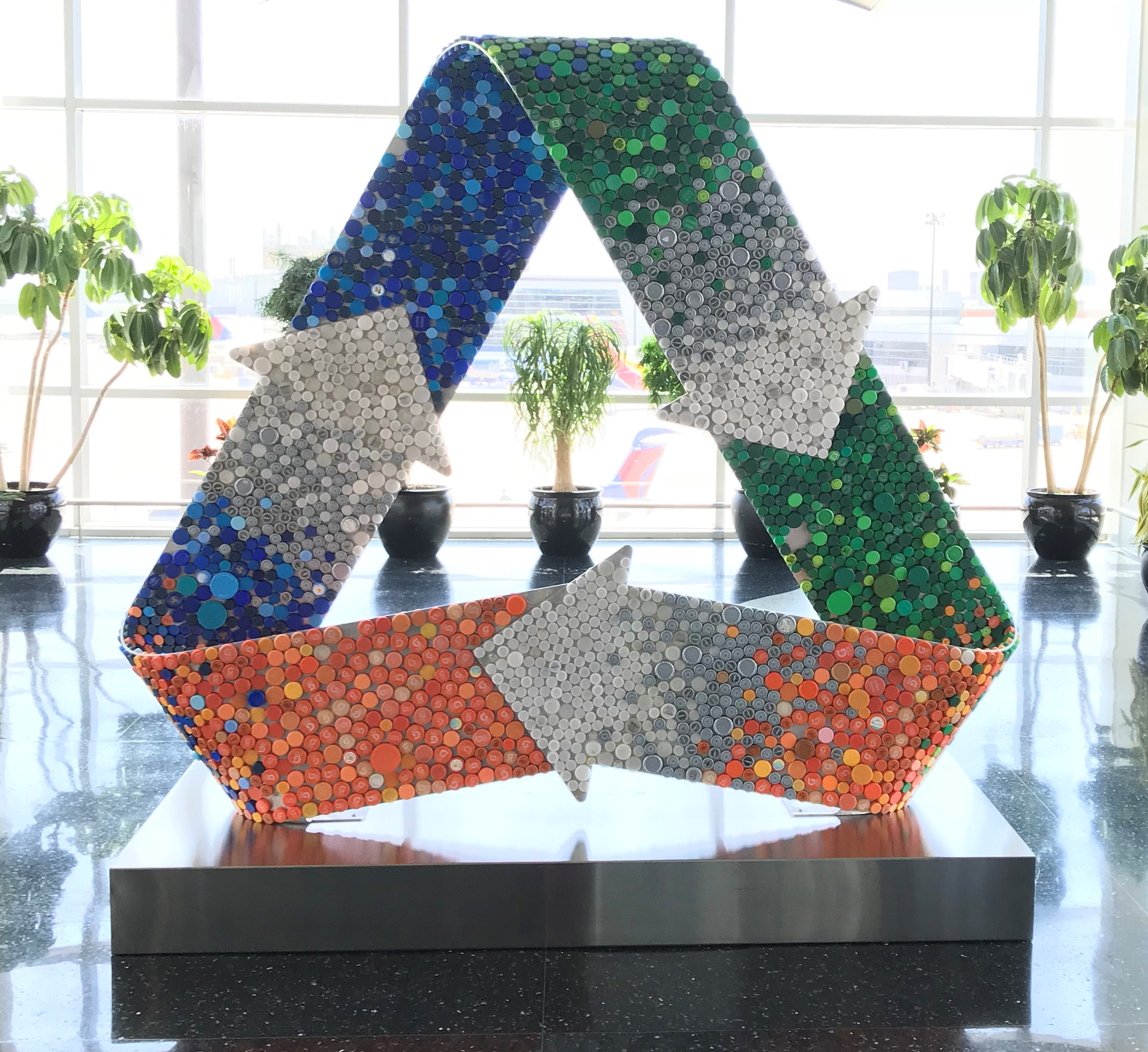 Recycle Symbol in Bottlecaps